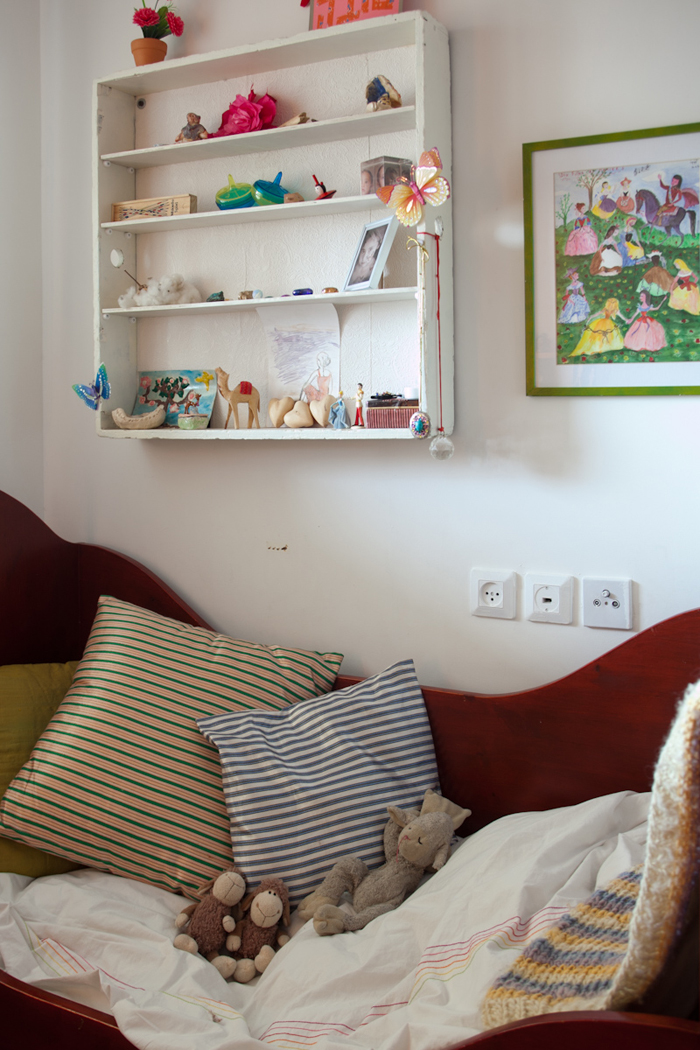 Shelf and bed in Alma and Nogah's bedroom in Jerusalem, featured on the Sleepykins home decor interior design series on the Babiekins Magazine blog