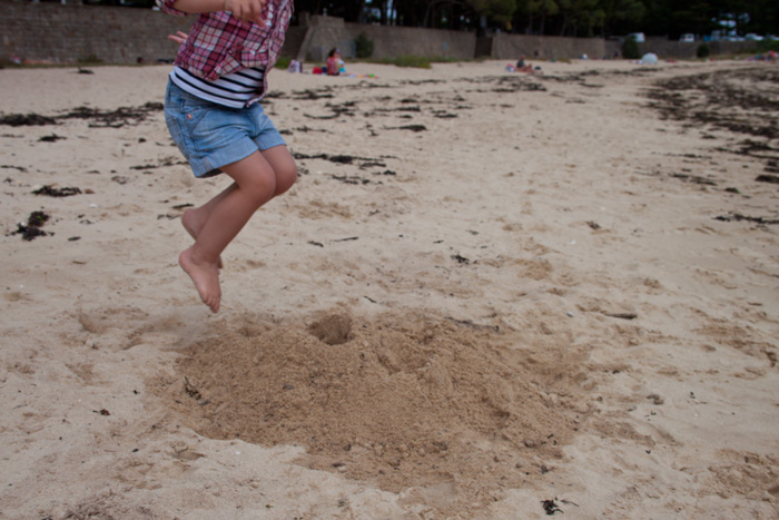 Babiekins Magazine | Travelkins | Brittany Jumping In Sand